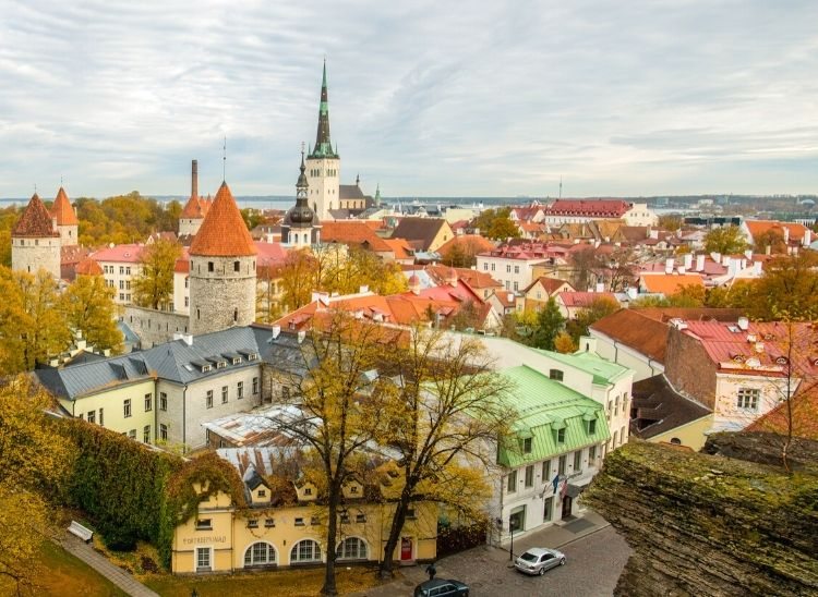 Climb Toompea Hill to witness the aerial view of tallinn old town with rising sun cast a rosy hue across the morning sky