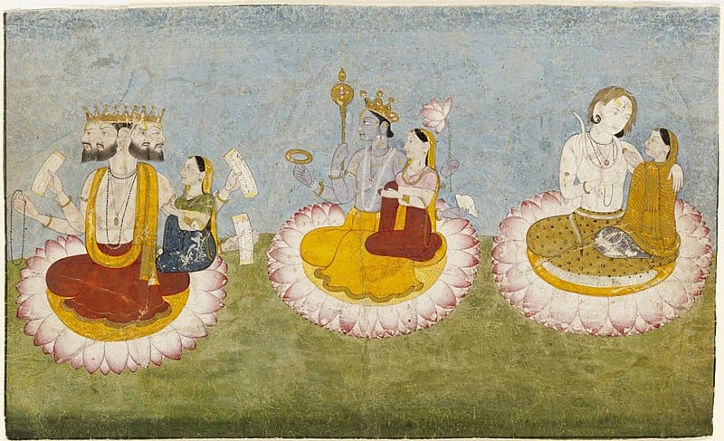 The three greatest Hindu deities are shown here together with their consorts. They are sometimes regarded as a trinity, who together represent aspects of the supreme godhead. The four-headed Brahma, holding copies of the oldest Indian sacred scriptures, the Vedas, together with his consort Saraswati, symbolises the power of creation. Next to him the blue Vishnu, with his consort Lakshmi, represents the energy that upholds and preserves creation. To their right Shiva, with his wife Parvati, embodies the power of destruction. All three divine couples sit on lotus flowers, which are one of the most ancient Indian symbols of purity and spiritual power.   Dawn of Durga Article Series   The tale of every woman   By Team Travelature